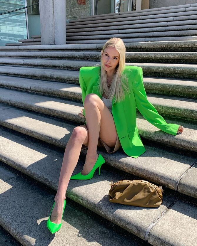 02 With a neon green blazer
