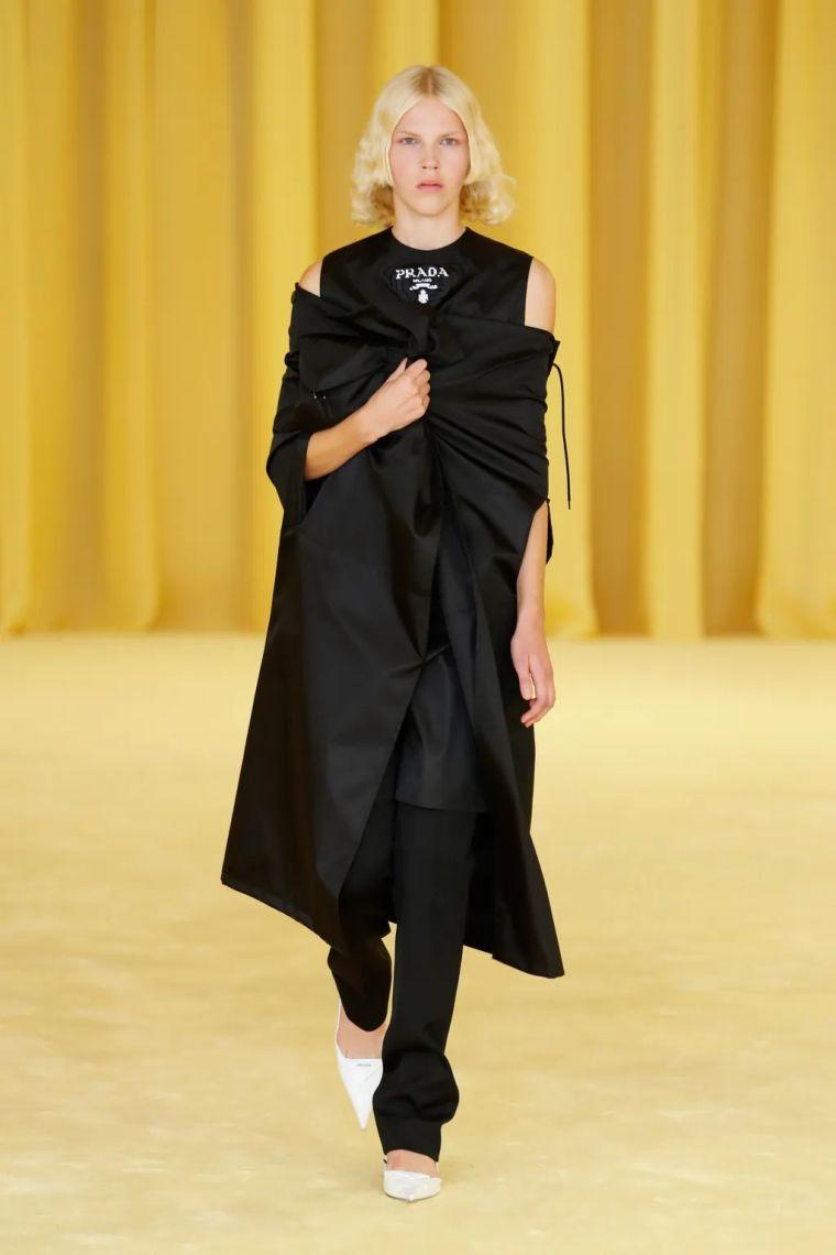 15. Classic cape in black by Prada