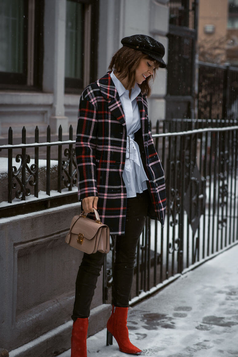 15. The plaid coat with red boots gave more life to the basic look