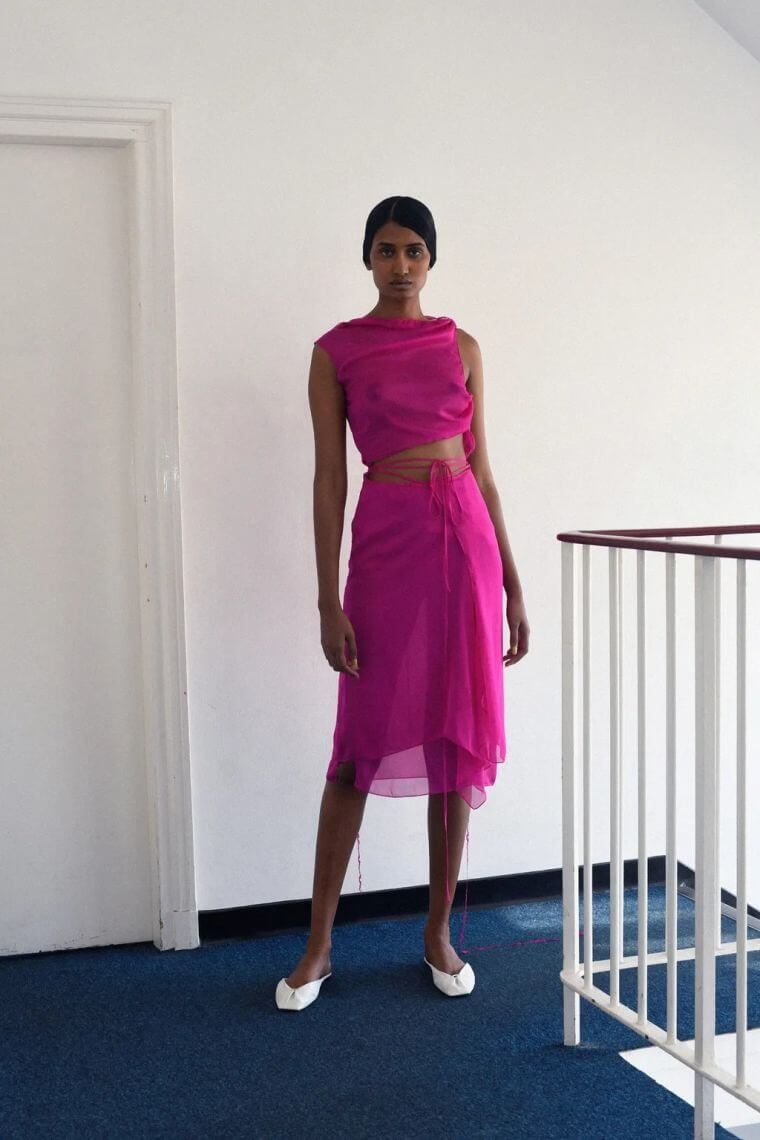 18. Skirt and top set in pink with straps around the belly