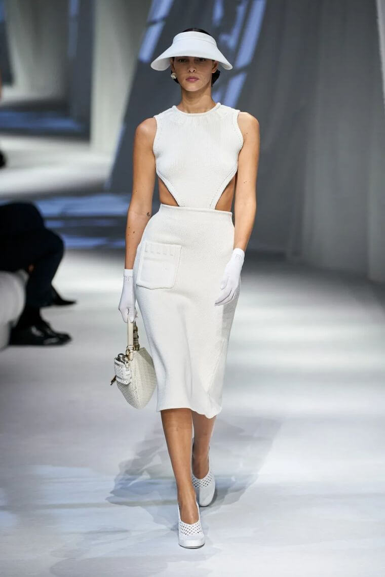 25. Elegant summer dress in white with cut out part