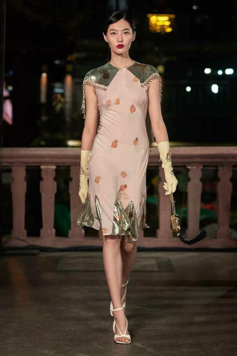 26. Evening dress with integrated little cape