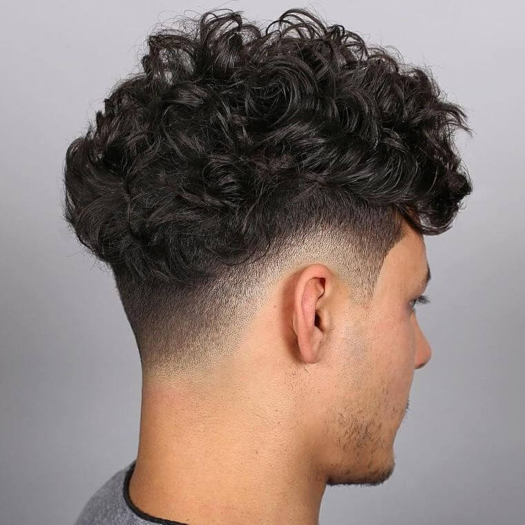 28. Fade top with curly top