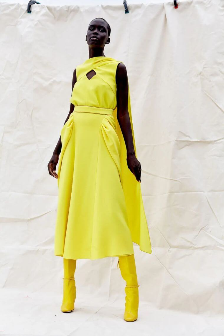 28. Yellow summer dress with a cutout part in front