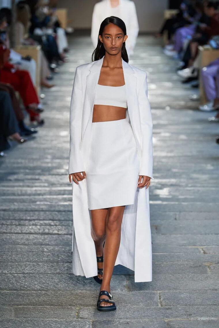 38. Woman summer clothes in white with bralette