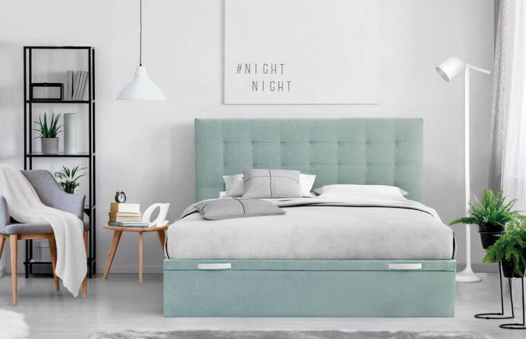 40. Minimalist style bedroom in white with original design bed in mint green